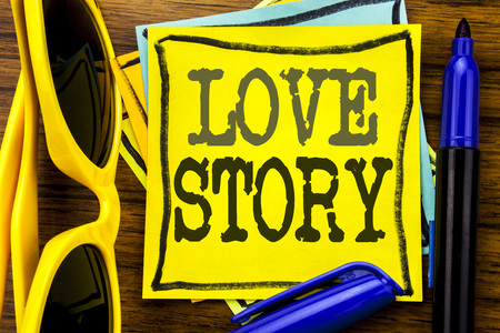 Hand writing text caption inspiration showing Love Story. Business concept for Loving Someone Heart  Written on sticky note paper, wooden background vacation sunglasses and bold marker 스톡 콘텐츠