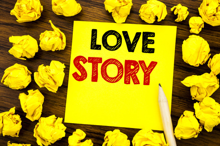 Writing text showing Love Story. Business concept for Loving Someone Heart  Written on sticky note paper, wooden background folded yellow paper meaning thinking