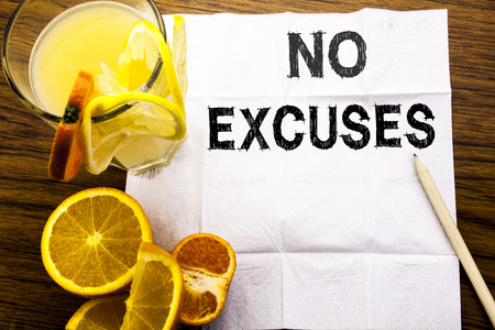 Conceptual text caption showing No Excuses. Concept for Stop Ban for Excuse written on tissue paper on wooden background with pen healthy juice and orange fruit in the restaurant