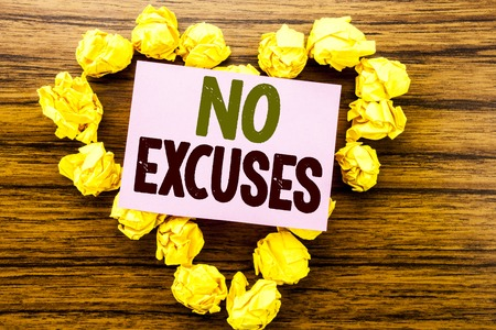 Word, writing No Excuses. Business concept for Stop Ban for Excuse written on sticky note paper on wooden background. Stock Photo