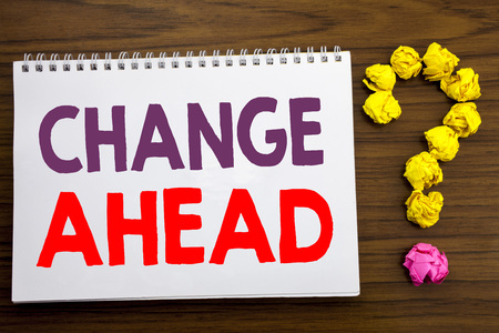 Conceptual hand writing caption inspiration showing Change Ahead Red Word. Business concept for Future Changes written on notepad paper on the wooden background with question mark.