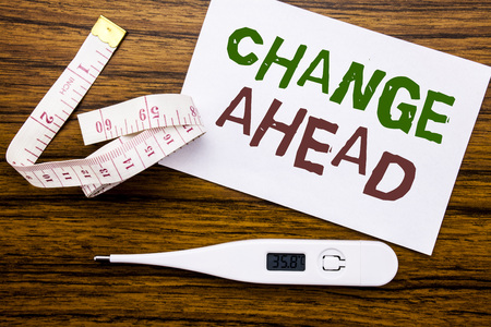 Conceptual hand writing text caption showing Change Ahead Red Word. Business concept for Future Changes written on sticky note paper wood background. Meter and thermometer for fitness subject.