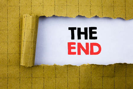 The End. Business concept for End Finish Close written on white paper on yellow folded paper.