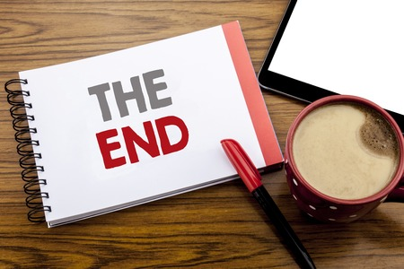 Handwriting Announcement text showing The End. Business concept for End Finish Close Written on notepad paper on wooden background with space office view with pencil marker