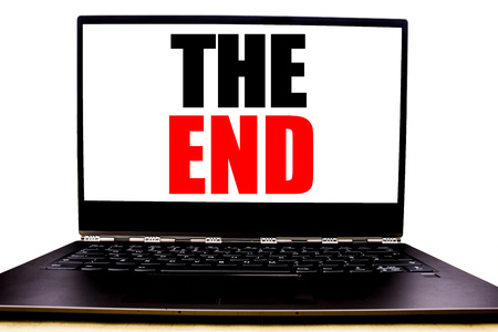 Handwritten text showing The End. Business concept writing for End Finish Close Written on monitor front screen, white background with space view. 스톡 콘텐츠