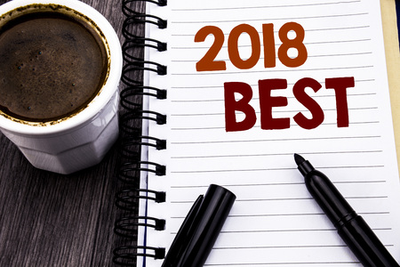 Writing text showing 2018 Best. Business concept for Choice Review written on notebook book note paper on wooden wood background. With coffee and black marker.