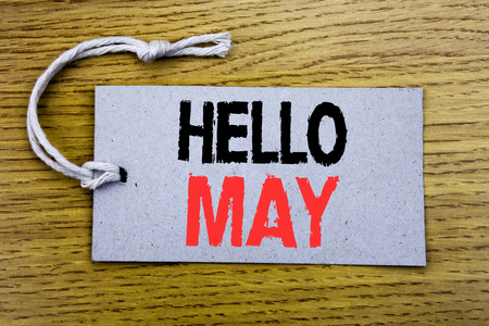 Conceptual hand writing text caption showing Hello May Month. Business concept for Coming Spring Month written on price tag paper with copy space on wooden vintage background Stock Photo