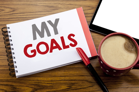 Handwriting Announcement text showing My Goals. Business concept for List Plan for Motivation Written on notepad paper on wooden background with space office view with pencil marker Stock Photo