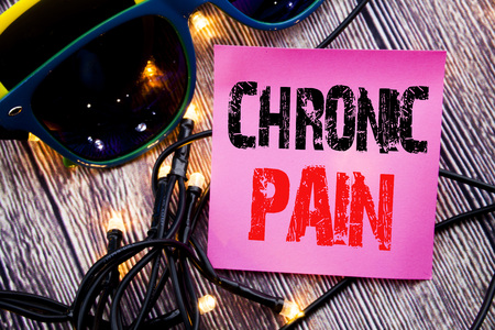 Hand writing text caption showing Chronic Pain. Business concept for Feeling Bad ill Care written on the wood with sunglasses copy space