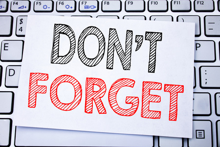 Handwritten text caption showing Do Not Forget. Business concept writing for Don t memory Remider written on sticky note paper on white keyboard background. Stok Fotoğraf
