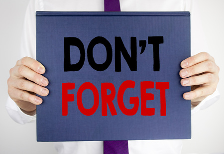 Writing text showing Do Not Forget. Business concept for Don t memory Remider written on book notebook paper holding by man in suit blurred background. Stock Photo