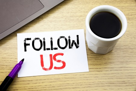 Handwriting Announcement text showing Follow Us. Business concept for Social Media Marketing written on notebook book on wooden background in the Office with laptop coffee