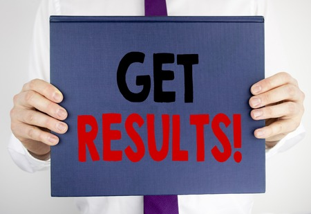 Writing text showing Get Results. Business concept for Achieve Result written on book notebook paper holding by man in suit blurred background.
