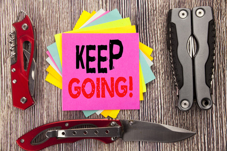 Writing text showing Keep Going. Business concept for Go Moving Forward Letting written on wooden background with pocket knife with space Stockfoto