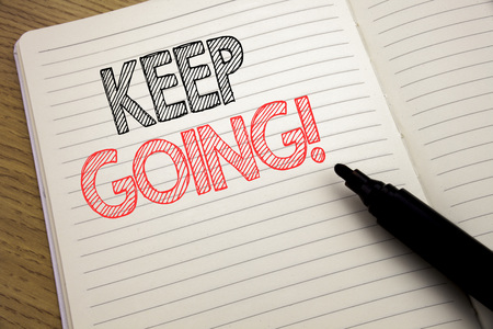 Handwriting Announcement text showing Keep Going. Business concept for Go Moving Forward Letting written on notebook with space on book background with marker pen