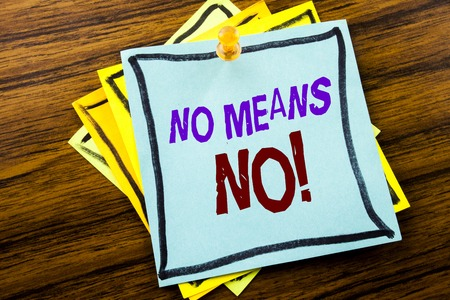 Writing text showing No Means No. Business concept for Stop Anti Rape Slogan written on sticky note paper on wooden background.