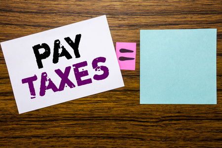 Handwriting Announcement text showing Pay Taxes. Business concept for Taxation Overtax Return written on sticky note paper wooden background. Equation mathematical sign for your space