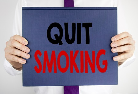 Writing text showing Quit Smoking. Business concept for Stop for Cigarette  written on book notebook paper holding by man in suit blurred background.