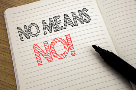 Handwriting Announcement text showing No Means No. Business concept for Stop Anti Rape Slogan written on notebook with space on book background with marker pen Stock Photo