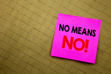 Handwritten text caption showing No Means No. Business concept writing for Stop Anti Rape Slogan written on sticky note paper on yellow background. Stock Photo