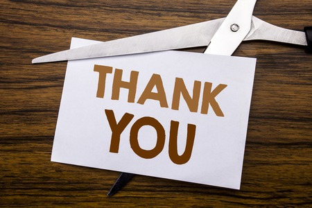 Hand writing text caption inspiration showing Thank You. Business concept for Gratitude Thanks Written on note, wooden with colourful scissors meaning destroy stop of something.
