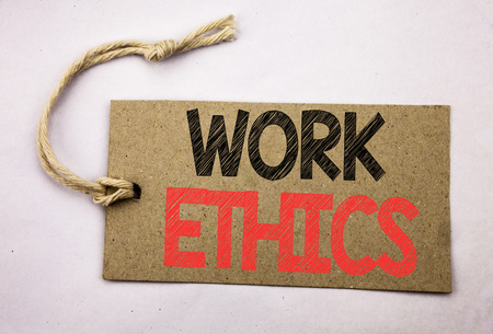 Hand writing text caption inspiration showing Work Ethics. Business concept for Moral Benefit Principles written on price tag paper on white vintage background.