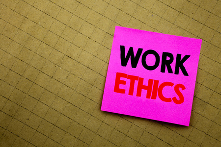 Handwritten text caption showing Work Ethics. Business concept writing for Moral Benefit Principles written on sticky note paper on yellow background.