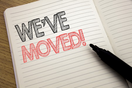 Handwriting Announcement text showing We Have Moved. Business concept for Company Changing Place written on notebook with space on book background with marker pen