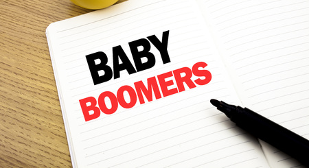 Conceptual hand writing text caption inspiration showing Baby Boomers. Business concept for Demographic Generation written on notebook with space on book background with marker pen