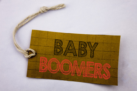 Handwriting Announcement text showing Baby Boomers. Business concept for online sale Demographic Generation written on price tag paper on white vintage background.
