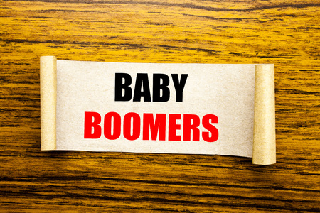 Hand writing text caption inspiration showing Baby Boomers. Business concept for Demographic Generation written on sticky note paper on wooden background. Stock Photo