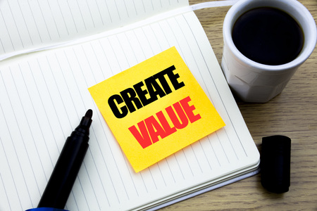 Hand writing text caption inspiration showing Create Value. Business concept for Creating Motivation written sticky note paper, Wooden background with copy space, Coffee and marker