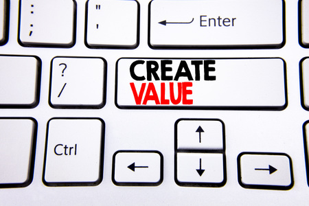 Hand writing text caption inspiration showing Create Value. Business concept for Creating Motivation written on white keyboard key with copy space. Top view