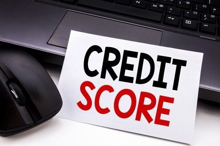 Conceptual hand writing text caption inspiration showing Credit Score. Business concept for Financial Rating Record written on sticky note paper on black keyboard background.