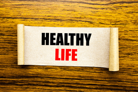 Hand writing text caption inspiration showing Healthy Life. Business concept for Good Health Food written on sticky note paper on wooden background. Archivio Fotografico