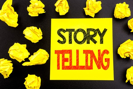 Conceptual hand writing text showing Storytelling. Business concept for Teller Story Message written on sticky note paper on black background. Folded yellow papers on the background