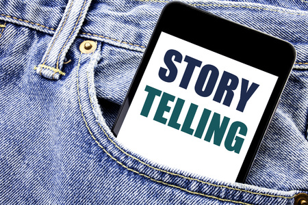 Conceptual hand writing text caption inspiration showing Storytelling. Business concept for Teller Story Message Written phone mobile phone, cellphone placed in man front jeans pocket.