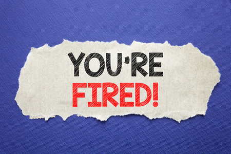 Handwriting Announcement text showing You Are Fired. Business concept for Unemployed or Discharge Written note paper with black background with space.