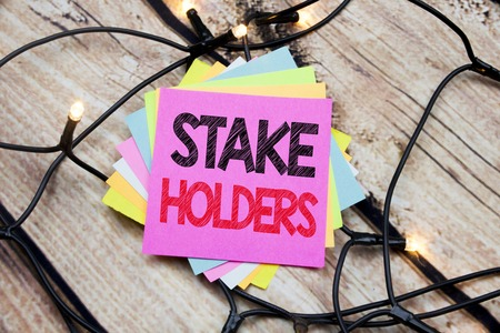 Handwriting Announcement text showing Stake Holders. Business concept for Stakeholder Engagement written on the wooden vintage background