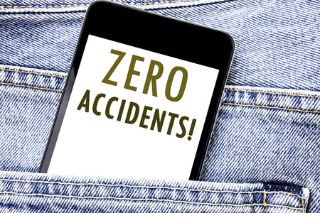 Handwriting Announcement text showing Zero Accidents. Business concept for Safety At Work Hazard Written phone mobile phone, cellphone placed in man front jeans pocket.