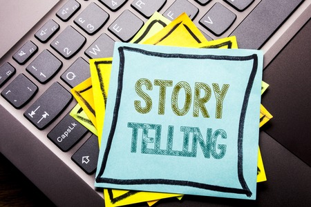 Conceptual hand writing text caption inspiration showing Storytelling. Business concept for Teller Story Message written on sticky note paper on dark keyboard background.