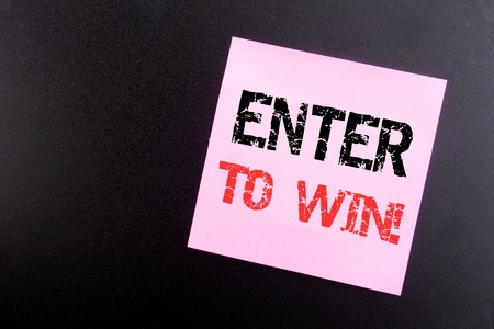Word, writing Enter to Win. Business concept for Winning in Competition written on sticky note, black background with space