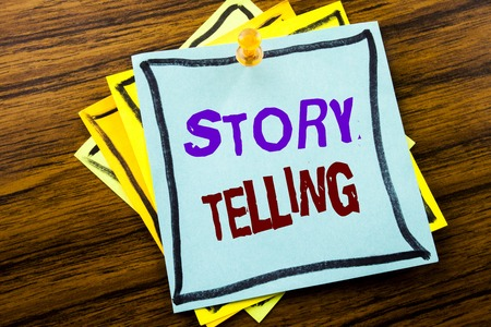 Writing text showing Storytelling. Business concept for Teller Story Message written on sticky note paper on wooden background.
