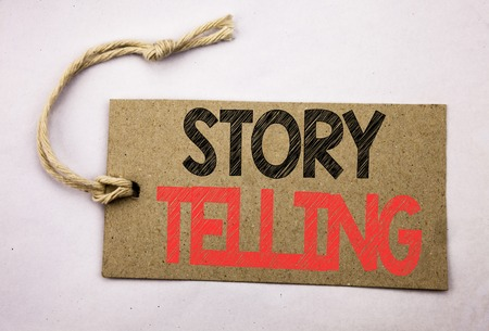 Hand writing text caption inspiration showing Storytelling. Business concept for Teller Story Message written on price tag paper on white vintage background.