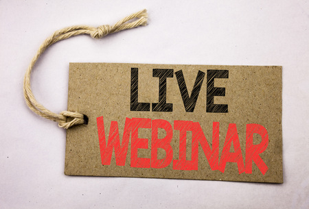 Hand writing text caption inspiration showing Live Webinar. Business concept for Business Web E-learning written on price tag paper on white vintage background. Zdjęcie Seryjne