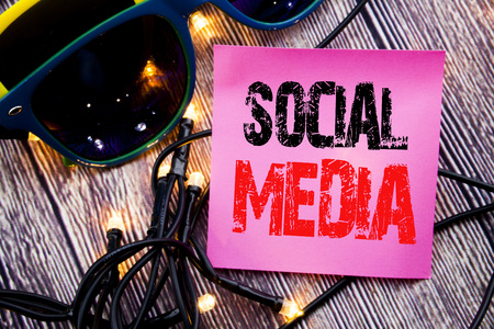 Hand writing text caption showing Social Media. Business concept for Global Internet Network written on the wood with sunglasses copy space