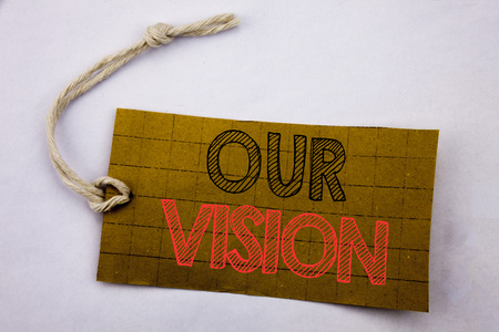 Handwriting Announcement text showing Our Vision. Business concept for online sale Marketing Strategy Vision written on price tag paper on white vintage background.