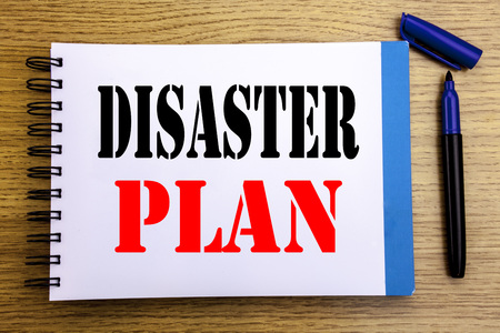Handwriting Announcement text showing Disaster Plan. Business concept for Emergency Recovery Written on notepad paper background with space office view with pencil marker Foto de archivo
