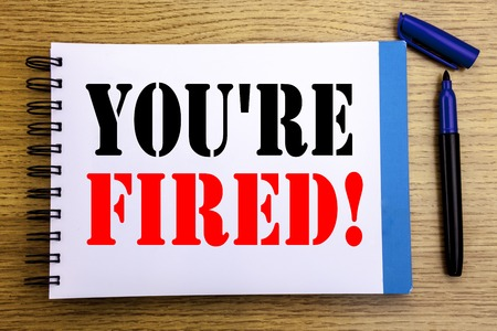 Handwriting Announcement text showing You Are Fired. Business concept for Unemployed or Discharge Written on notepad paper background with space office view with pencil marker Stock Photo