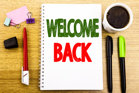 Hand writing text caption showing Welcome Back. Business concept for Emotion Greeting Written on notepad paper background with space office view with pencil marker coffee Фото со стока